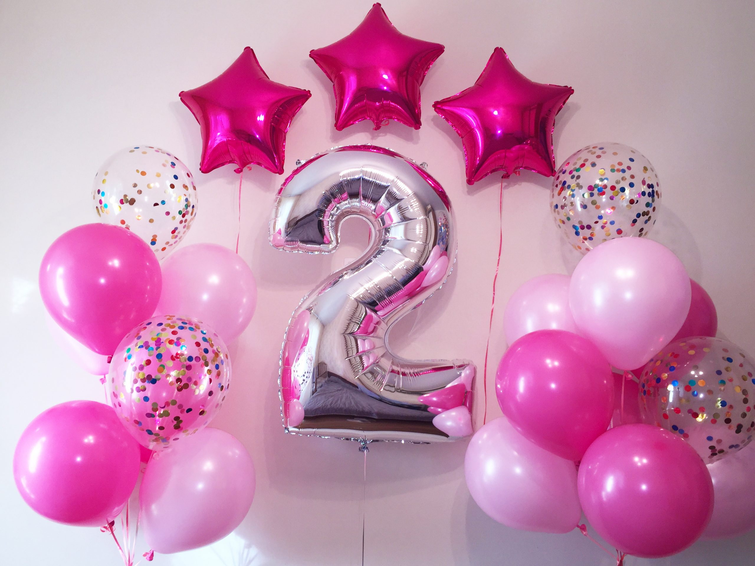 Girl's 2nd birthday party helium balloons decoration